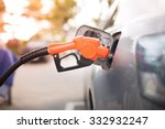gas pump nozzle in the fuel... | Shutterstock . vector #332932247