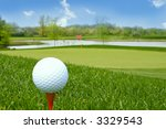 golf ball on tee golf course background - stock photo