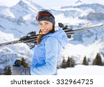 Young Woman With Ski In Winter
