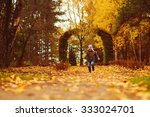 Child Walks In Autumn Park