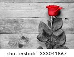 Stock photo red rose on black and white wooden background 333041867