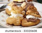 Hungarian creamy doughnuts on a plate - stock photo