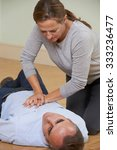 woman performing cpr on man... | Shutterstock . vector #333236477