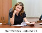 businesswoman reading documents | Shutterstock . vector #33335974