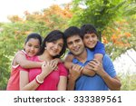 portrait of family in park | Shutterstock . vector #333389561