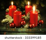 Small photo of Xmas Advent wreath with three lighted candles for the 4th advent sunday rustic christmas traditional concept