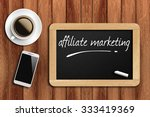 Small photo of The coffee, phone and chalkboard with word affiliate marketing