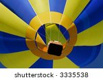Close-up view of a colorful hot air balloon lifting off - stock photo
