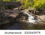 Creek Waterfall With Stone Arc...