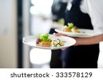 waiter carrying plates with... | Shutterstock . vector #333578129