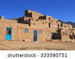 The Taos pueblo in New Mexico features adobe structures stacked atop each other.