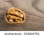 walnuts on wooden background | Shutterstock . vector #333604781
