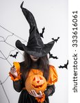 girl in witch clothing ... | Shutterstock . vector #333616061