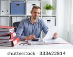 young businessman calculates... | Shutterstock . vector #333622814