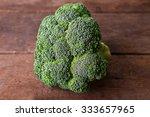 fresh broccoli on wooden...   Shutterstock . vector #333657965