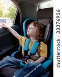 child in a car. traveling with... | Shutterstock . vector #33376936