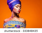 African Woman In A Bright Dres...