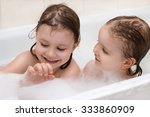 two adorable little girls...   Shutterstock . vector #333860909