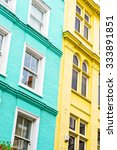Small photo of Blue and yellow adjoining London townhouses
