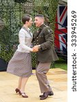 FORT GEORGE, SCOTLAND - AUGUST 8: Unidentified dancers in WW2 costume at Fort George, Scotland, 8 August 2015. - stock photo