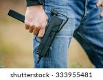man in a jeans holding a... | Shutterstock . vector #333955481