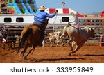 A Cowboy Chasing A Bull With A...