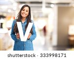 happy young woman with letter v | Shutterstock . vector #333998171