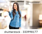 happy young woman showing... | Shutterstock . vector #333998177