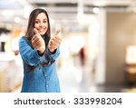 happy young woman okay sign | Shutterstock . vector #333998204