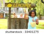 Girl Holding Lemonade In Front...