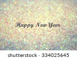 text happy new year on blurred... | Shutterstock . vector #334025645