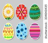 painted flat design easter eggs.... | Shutterstock .eps vector #334043435