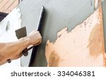 the process of putty the walls... | Shutterstock . vector #334046381