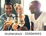 ethnic friends drinking wine at ... | Shutterstock . vector #334064441