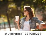 young stylish woman drinking... | Shutterstock . vector #334085219