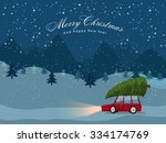 man carries a xmas tree by the... | Shutterstock .eps vector #334174769