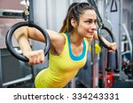 smiling woman exercising her... | Shutterstock . vector #334243331