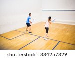 couple playing a game of squash ... | Shutterstock . vector #334257329
