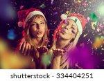 two beautiful young girls...   Shutterstock . vector #334404251