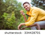 fit man eating an apple in the... | Shutterstock . vector #334428701