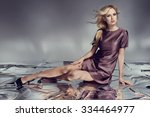 beautiful blonde young woman in ... | Shutterstock . vector #334464977