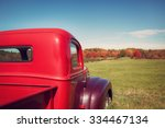 Old Red Farm Truck Against...