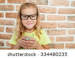 beautiful smiling little girl... | Shutterstock . vector #334480235