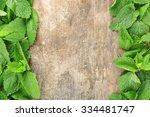 frame of fresh mint on wooden... | Shutterstock . vector #334481747