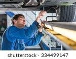 Mechanic  Examining The...