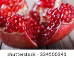 Ripe pomegranate fruit on wooden background.selective focus. closeup - stock photo