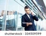 attractive young businessman... | Shutterstock . vector #334509599