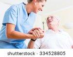 nurse holding hand of senior...   Shutterstock . vector #334528805