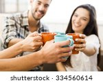 group of friends making a toast ... | Shutterstock . vector #334560614