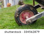 Dirty Tire Of Wheelbarrow With...